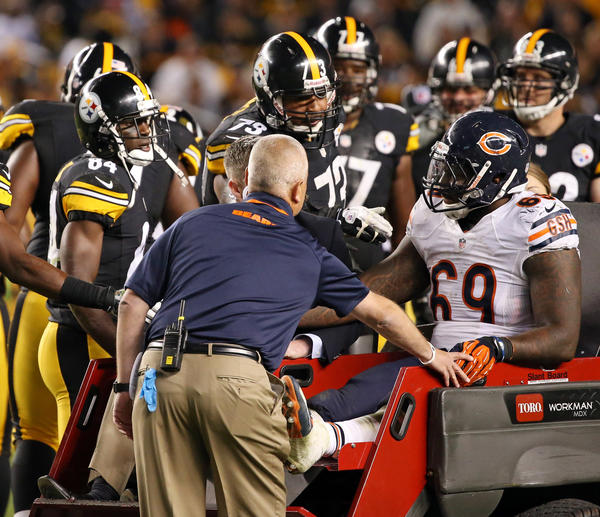 Bears defensive tackle Henry Melton is consoled by Steelers players as he is helped off after tearing his ACL on Sunday.