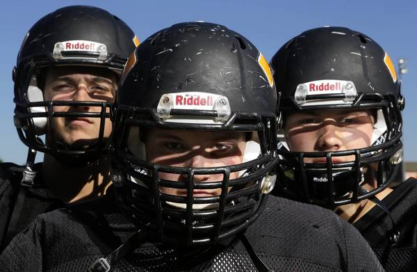 Jonathon Gruenke/Daily Press Photo Tabb High School offensive linemen Nick Beaton, left, Matt Staul, center, and Mark Youker lead the way as seniors and contribute to the team's rushing success.