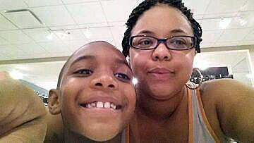 Millicent Brown-Johnson and her eight-year-old son Jovan Perkins died in a suspected arson fire in their third floor apartment on the 11200 block of South Martin Luther King Drive on Sept. 21, 2013.