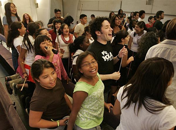 Gustavo Dudamel rehearsing members of YOLA for their Hollywood Bowl debut in 2009.