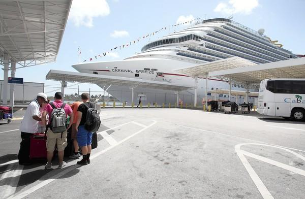 Carnival Corp., the world's largest cruise company, runs 100 ships under 10 brands. Above, the Carnival Breeze is docked at the port of Miami.