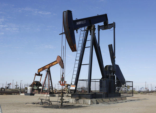 Oil pumps operate near Lost Hills, Calif. An initiative drive to create an oil tax in California fell short this week.
