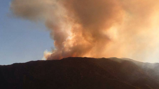 Smoke billows from the Sierra fire burning in the Cajon Pass.
