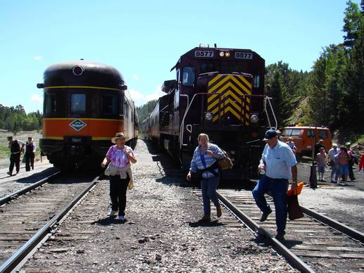 Passengers head for an outdoor concert after two trains of the Rio Grande Scenic Railroad arrive