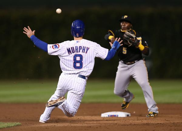 Donnie Murphy is forced at second as Pirates infielder Josh Harrison turns a double play.