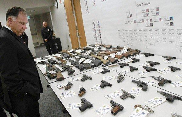 Orange County Dist. Atty. Tony Rackauckas looks at some of the weapons seized during the 2 1/2-year-long Operation Smokin' Aces.