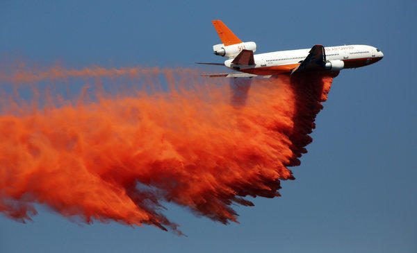 A DC-10 drops retardant Tuesday on the Madre fire in the Angeles National Forest above Azusa. A DC-10 was also used to battle the Sierra fire in the Cajon Pass.