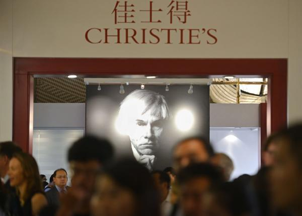 Guests gather at a preview of Christie's auction in Shanghai.