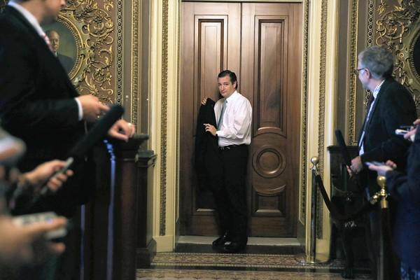 Sen. Ted Cruz (R-Texas) leaves after a Republican policy lunch meeting on Capitol Hill. He's leading the GOP charge to defund the Affordable Care Act in the Senate spending bill.
