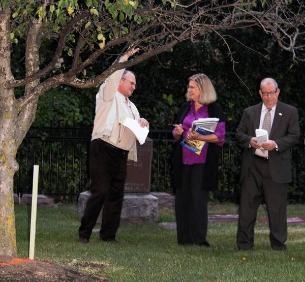 Deerfield Cemetery Commission members Daniel Ziemba, from left, Jean Spagnoli  and Chairman Maynard Grossman identify a tree slated for removal at  the cemetery founded in 1858.