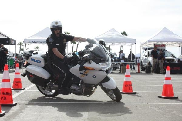 "Burbank Police Officer Ryan Murphy competed in the Orange County Traffic Officers Assn.'s ""Top Gun"" Motor Rodeo last week and made it to the semifinals in the competition where officers navigated a series of traffic-cone patterns."