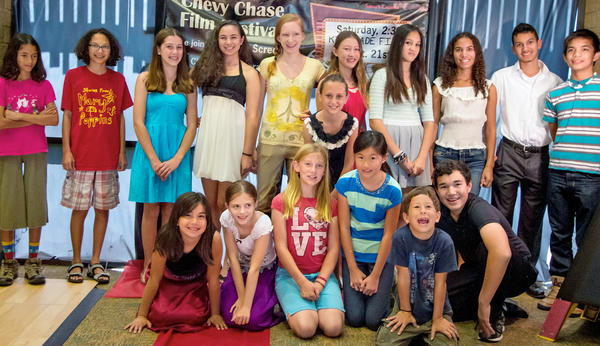 Young filmmakers pose for a photo during the Chevy Chase Film Festival that occurred at the Chevy Chase Library on Sept. 21. Seventeen children and teens wrote scripts and directed films featuring characters from poems, short stories or novels.