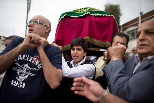 A coffin is carried during a funeral procession for Selima Merali, 41, and her daughter Nuriana, 15, who were killed in the Westgate mall attack in Nairobi, Kenya.