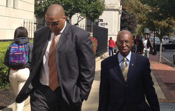 Tate George, left, heads back into court in Trenton, N.J. after lunch with his mentor, Enrique Riley.