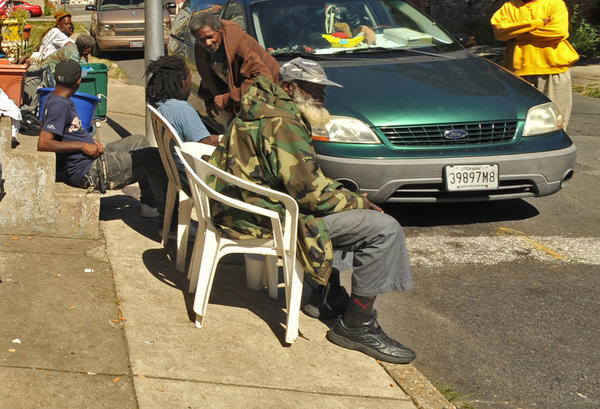 "Ralph ""Pops"" Gatheright, seated in front, chats with neighbors in the 1600 block of North Bethel Street."