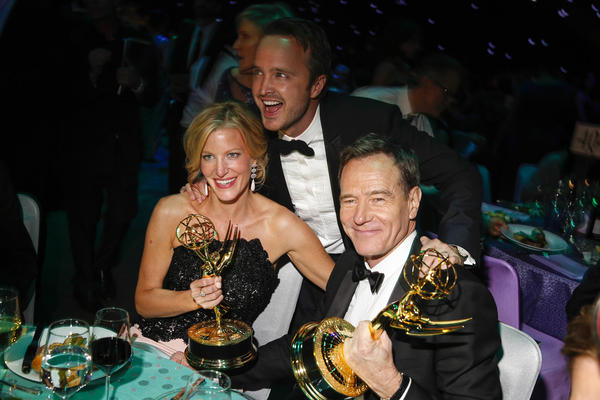 "At the Governor's Ball, Anna Gunn, Aaron Paul, center, and Bryan Cranston of ""Breaking Bad"" celebrate Gunn's win for supporting actress in a drama series and the show's win for outstanding drama series."