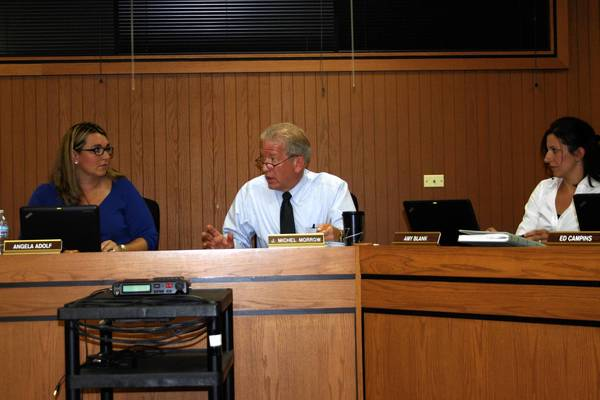Superintendent J. Michel Morrow, center, makes a point during the Sept. 24 Homer Community Consolidated School District 33C board meeting. Morrow is retiring June 30 after 24 years with the district. Looking on are school board President Angela Adolf, left, and board member Amy Blank.