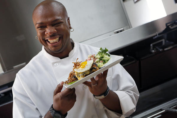 Chef Aaron McCargo prepares an artfully arranged chicken, egg and hash brown stack at McDonald's production studio in the City of Industry in preparation for the celebrity-chef dinner.