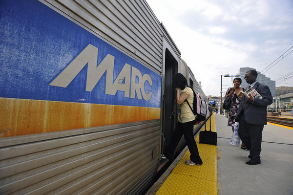 Commuters board a southbound Marc train at Camden Station.