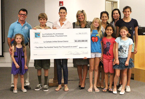 La Cañada Flintridge Educational Foundation administrators and their children present a big check to the La Canada Unified School District on Tuesday, September 24, 2013.
