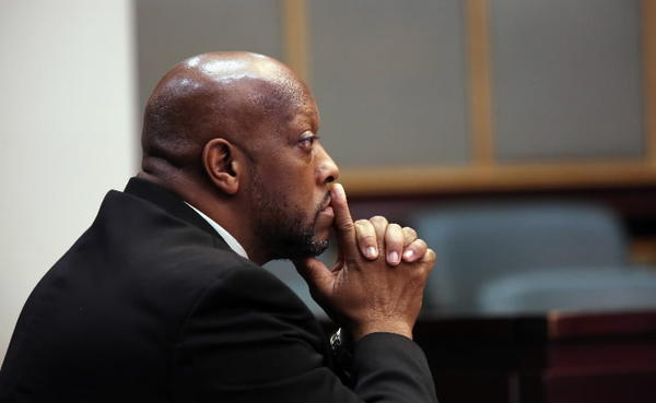 Roderick Johnson, a retired Orlando officer accused of coercing sex with an arrested woman in a police substation last year, at his trial on September 25, 2013.