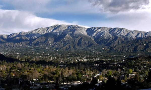 A dusting of snow can be seen, from Glendale College, in the Angeles National Forest north of La Crescenta, Glendale and La Cañada Flintridge on Wednesday, Feb. 20, 2013. Members of the city's Planning Commission decided not to move forward with the development of a view preservation regulation, although some said they would like to study the issue in the future. Such a measure would protect hillside properties that offer views of the mountains from obstructions like trees and vegetation.