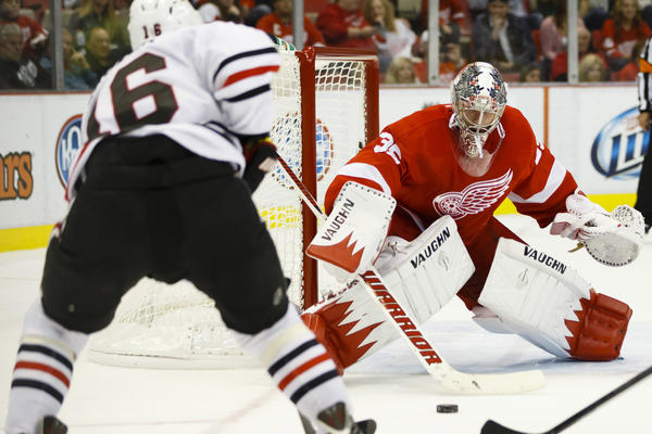 Red Wings goalie Jimmy Howard makes a save on a shot by Marcus Kruger in the second period.