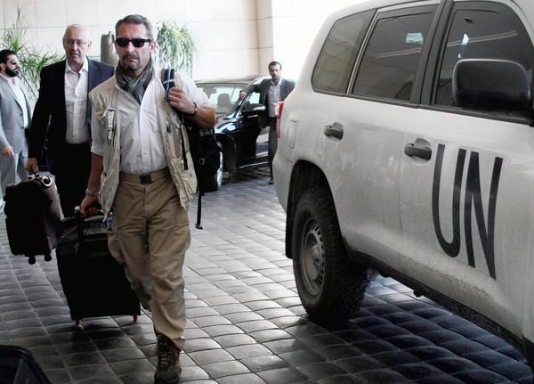 U.N. experts arrive at the Four Seasons Hotel in Damascus to continue the investigation of chemical weapons use in Syria's civil war.