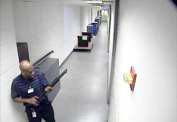 This image from video provided by the FBI shows Aaron Alexis moving through a hallway at the Washington Navy Yard during his rampage.