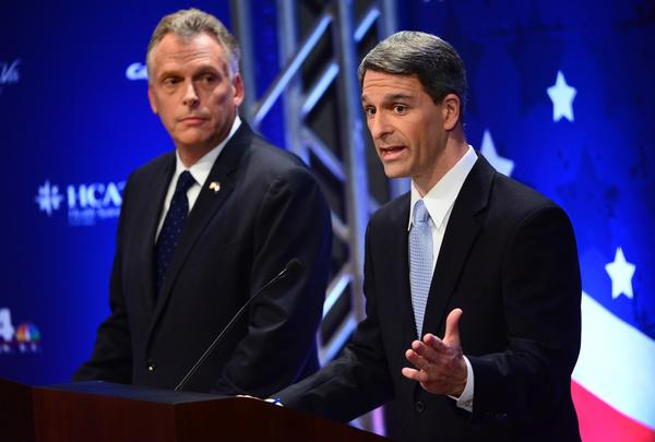 Virginia Attorney General and Republican candidate Ken Cuccinelli, right, speaks during a debate with former DNC Chair and Democratic candidate Terry McAuliff, left, on September 25, 2013 in McLean, Virginia. Voters go to the polls November 5 to decide which candidate will replace incumbent governor Bob McDonnell, who has reached his term limits.
