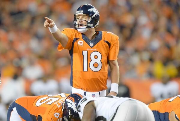 Sep 23, 2013; Denver, CO, USA; Denver Broncos quarterback Peyton Manning (17) gestures during the game against the Oakland Raiders at Sports Authority Field at Mile High.