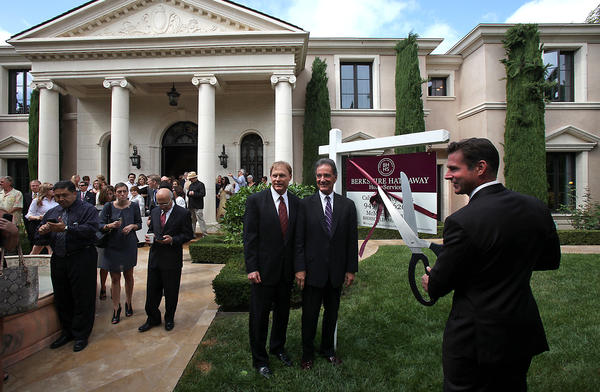 From left, Scott McDonald, VP of Berkshire Hathaway HomeServices California Properties, David Cabot, CEO, and John McGonigle, listing agent, cut the ribbon at a ceremony Wednesday at Villa Pietra.
