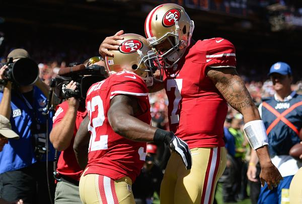 Kendall Hunter and Colin Kaepernick celebrate after Hunter scored on a 13-yard touchdown run.