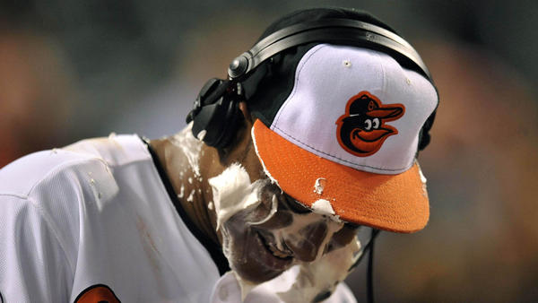 Orioles second baseman Jonathan Schoop gets a shaving cream pie after making his major league debut.