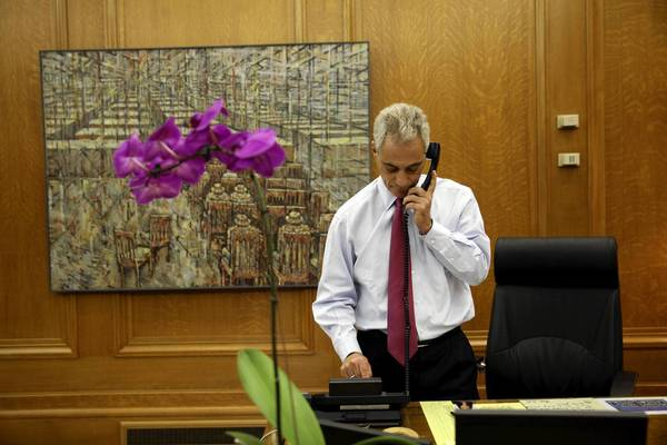 Mayor Rahm Emanuel spends some time on the phone in City Hall on Wednesday.