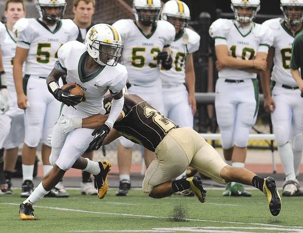 Emmaus's Kyzir White gets past Becahi's Duane Schmoyer during Saturday's game at Bethlehem. Emmaus won over Bethlehem Catholic 35 to 0 and the game was called in the last quarter due to weather Saturday, August 8, 2012. BEN MORRISON/THE MORNING CALL