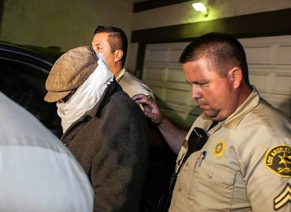 Nakoula Basseley Nakoula is escorted out of his home by Los Angeles County Sheriff's officers in Cerritos, Calif.