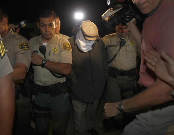 Los Angeles County Sheriff's deputies take Nakoula Basseley Nakoula into custody.