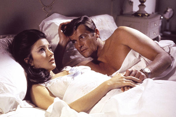 "Jane Seymour, left, and Roger Moore as 007 in the 1973 James Bond film ""Live and Let Die."" Was Bond looking for love?"