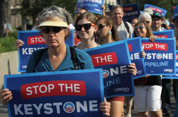 Activists march to State Department headquarters in Washington to protest against the Keystone XL pipeline.