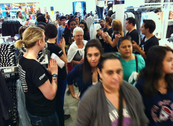The long lines of shoppers flow into the new H&M store in Pembroke Lakes Mall Thursday.