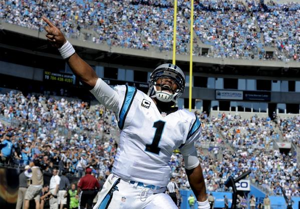 Carolina Panthers quarterback Cam Newton celebrates a touchdown Sunday in Charlotte, N.C.