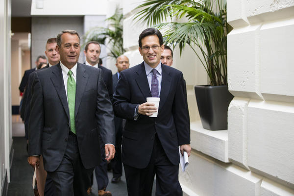 House Speaker John A. Boehner of Ohio, left, and House Majority Leader Eric Cantor of Virginia walk to a Republican caucus Thursday on Capitol Hill.