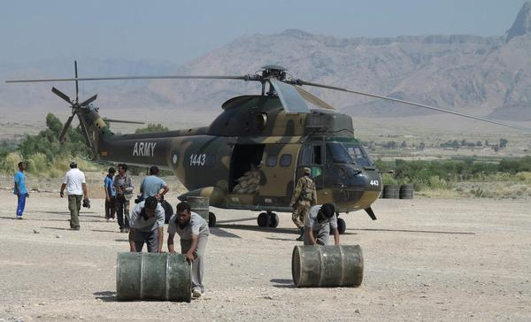 Soldiers unload relief goods for people affected by the earthquake that struck southwestern Pakistan.