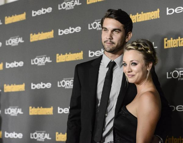 Actress Kaley Cuoco and Ryan Sweeting arrive at an Emmy party on Friday.