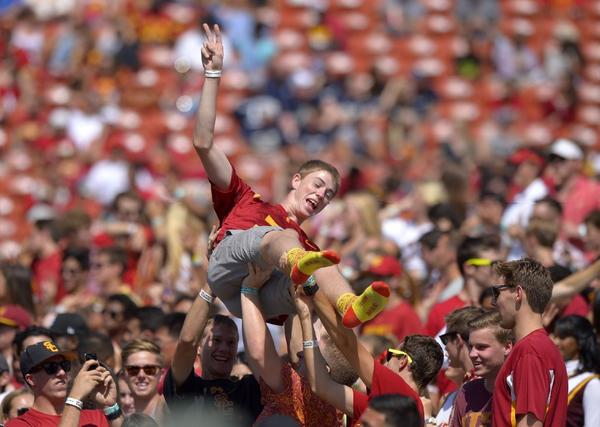 A USC fan is lifted during the Trojans' game against Utah State on Saturday.