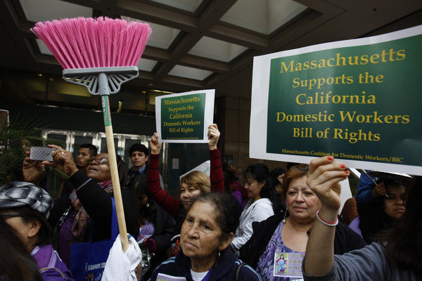 Domestic workers and community leaders from California and across the country rallied in downtown Los Angeles in March in support of AB 241, which extends eligibility for overtime pay to domestic workers. Gov. Jerry Brown signed the measure Thursday.