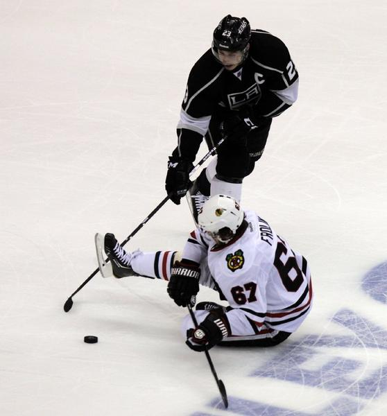 Chicago Blackhawks center Michael Frolik and Kings right wing Dustin Brown battle for the puck at Staples Center.
