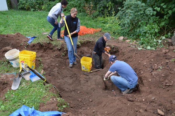 A crew assisting town police at 24 Pine Hill St. included, left to right, an unnamed University of Connecticut student volunteer; Deborah Surabian, a soil scientist; State Archaeologist Nicholas Bellantoni; and Richard Gonzalez, assistant professor of medical sciences at Quinnipiac University.
