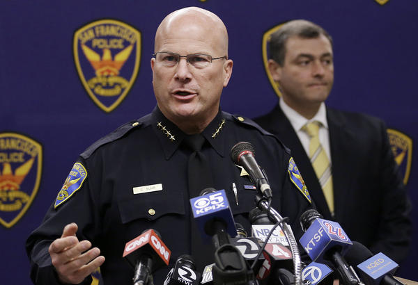 San Francisco Police Chief Greg Suhr speaks at a news conference in San Francisco. Police have taken into custody two people in the fatal stabbing of a Los Angeles Dodgers baseball fan during a fight near AT&T Park after the Giants' 6-4 win Wednesday.